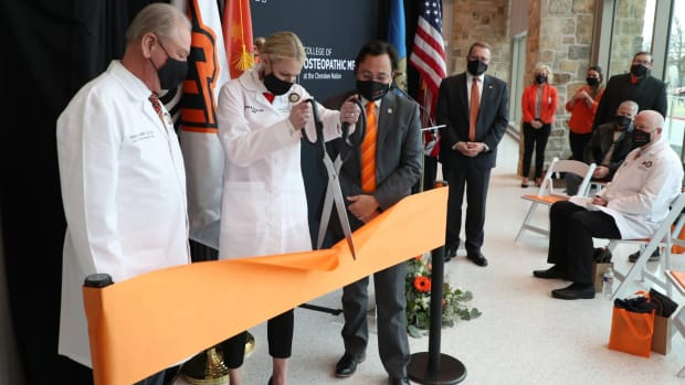 Dr. William Pettit (left), Dr. Kayse Shrum and Chuck Hoskin, Jr., take part in a ribbon-cutting at the Oklahoma State University College of Osteopathic Medicine at the Cherokee Nation in Tahlequah, Oklahoma, on Friday, January 15, 2021. (Photo courtesy of Oklahoma State University College of Osteopathic Medicine)
