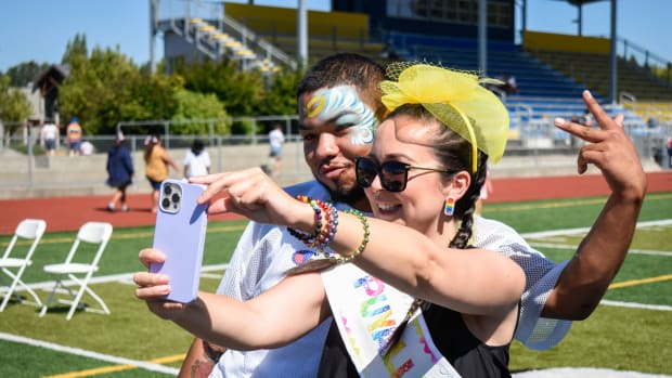 Phoenix Johnson, right, a Two Spirit member of the Tlingit and Haida Nation, takes a selfie with Elijah Campbell from the Ho-Chunk Nation of Wisconsin at The Puyallup Tribe of Indians' third annual Pride Celebration Sunday, July 25, 2021, at Chief Leschi Schools in Tacoma, Wash. The pair were among five event attendees chosen as Puyallup Pride Royalty. (Photo by The Bellingham Herald)