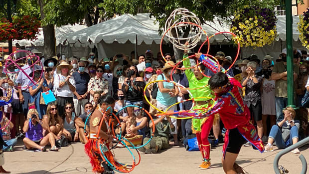 Hoop dancing at the 99th Santa Fe Indian Market in the Santa Fe Plaza in Santa Fe, New Mexico, on August 21, 2021. (Photo by Jourdan Bennett-Begaye, ICT)