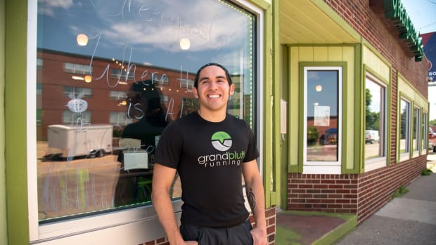 """Donald Robert Greengrass Jr. is seen outside his La Crosse, Wis., business Greengrass Cafe, which he opened with money he received from the Ho-Chunk Nation's Child Trust Fund Program when he turned 18. Policy makers have proposed a similar national """"baby bond"""" program to help low-income children entering adulthood have a nest egg they could use to pay for college, buy a house or pay for necessities. Photo taken July 12, 2021. (Photo by Will Cioci, Wisconsin Watch)"""