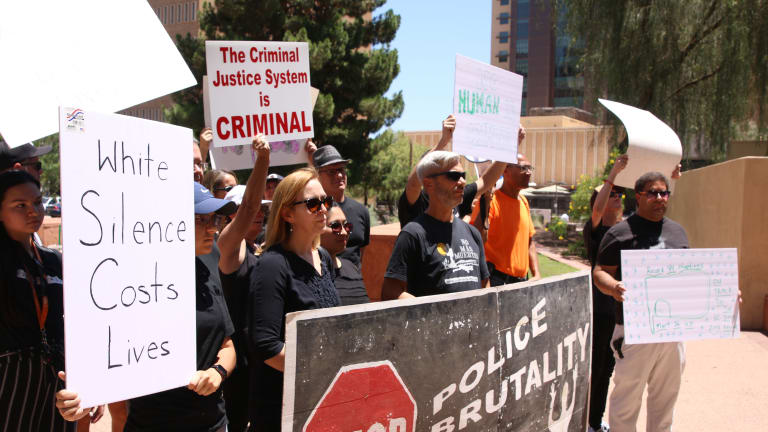Protesters rally at Phoenix City Council meeting over viral video of police encounter