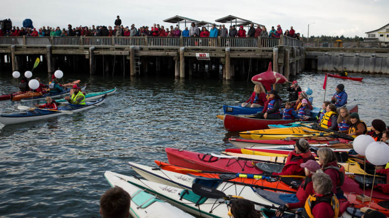 Indigenous-led event at Canadian-US border draws crowds on land and water