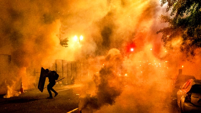 Federal agents use tear gas to clear Portland protest