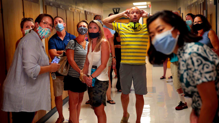 Parents agonize over back-to-school decisions amid pandemic