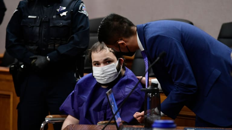 Colorado shooting suspect makes his 1st court appearance