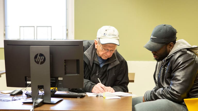 Black Hills State University accounting majors assist community members with tax preparation