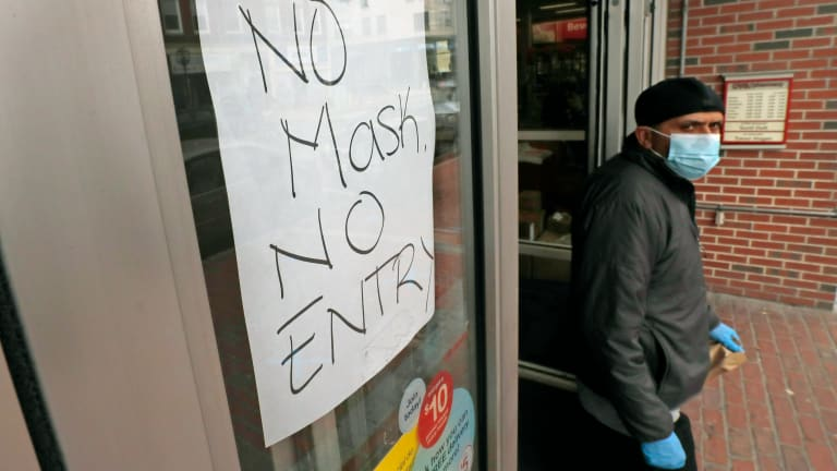 Store workers tasked with enforcing social-distance rules