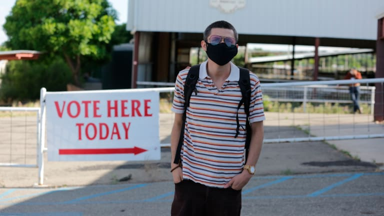 Polls start closing as voters navigate protests, virus