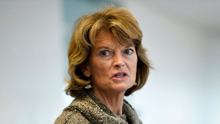 Republican Sen. Lisa Murkowski says she's struggling with supporting Trump