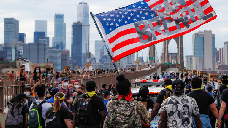 When protesters cry, 'Defund the police,' what does it mean?