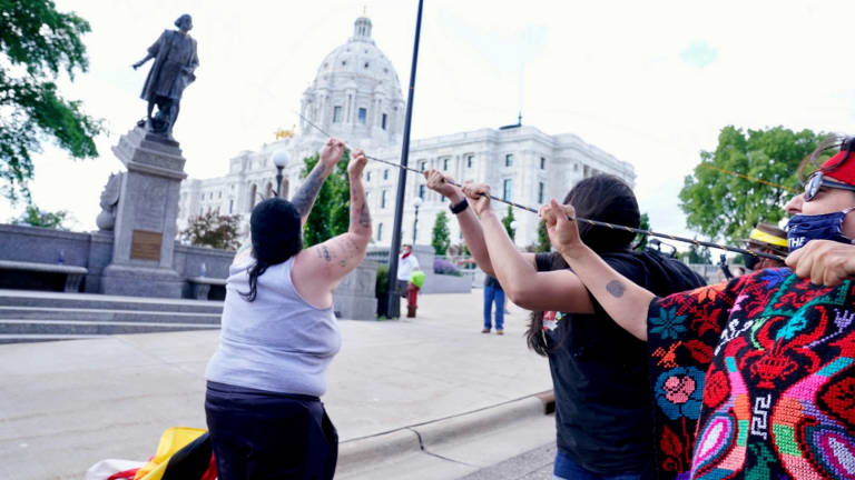 Columbus takes another dive: Protesters topple Minnesota statute