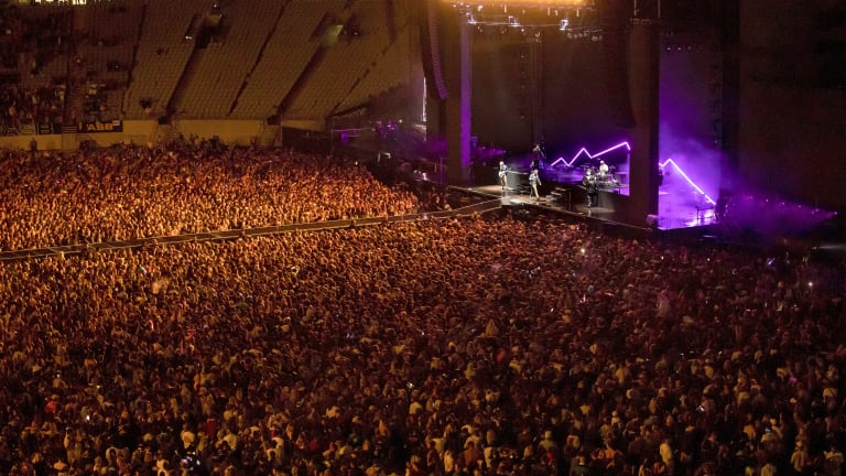 The world isolates. A New Zealand band plays to 50,000 fans