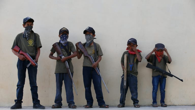 Why some Mexican villages arm children
