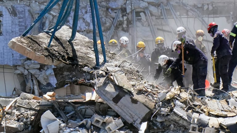 Briefs: Rescuers hope to find more survivors in rubble