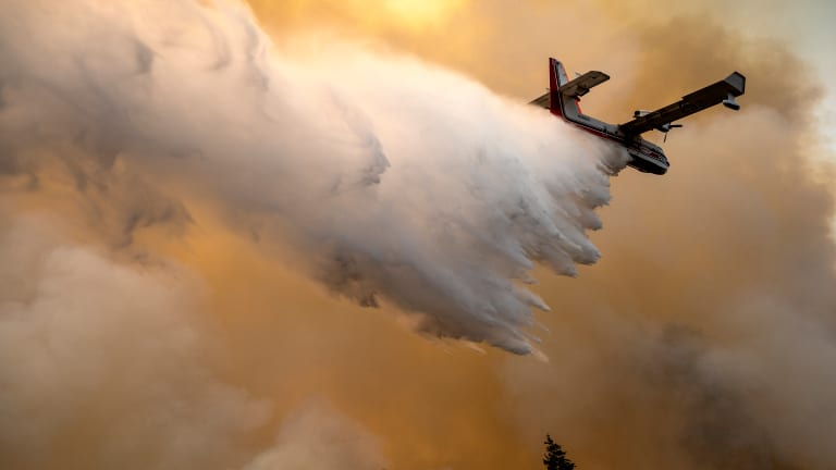 Wildfires calm down in cool weather, but losses grow