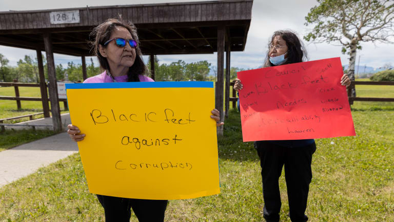 Marietta Green, left, and Leona Gopher protest outside the Blackfeet administration building in Browning, Montana. Protesters demand transparency in accounting for how federal COVID-19 relief funds were spent. (Photo by Beth Wallis/News21)