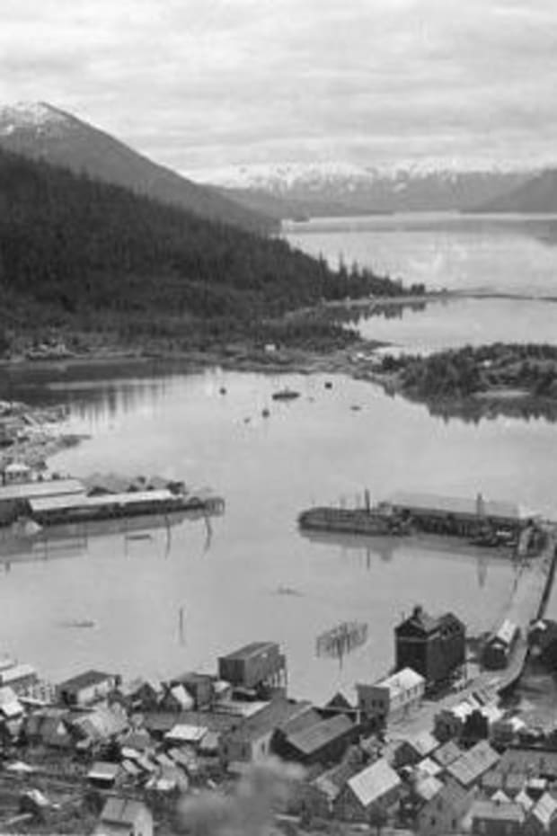 """Village of Wrangell, ca. 1897, one of the five """"landless"""" communities in Southeast Alaska whose Native residents were excluded from full participation in the Alaska Native Claims Settlement Act. Ironically, Wrangell was the hometown of William Paul, Sr., the pioneering Tlingit civil rights leader who is considered one of the fathers of the Native land claims movement. (Photo courtesy of the University of Washington Libraries)"""