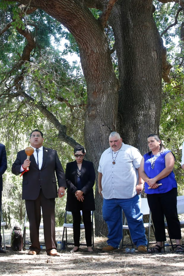 Assemblyman James Ramos, D-Highlands, of the San Manuel Band of Mission Indians, fifth from left, opens a meeting with tribal leaders from around the state, attended by Gov. Gavin Newsom, fourth from left, at the future site of the California Indian Heritage Center in West Sacramento, Calif., Tuesday, June 18, 2019. Newsom took the occasion to formally apologize to tribal leaders from around California for the violence, mistreatment and neglect inflicted on Native Americans throughout the state's history.