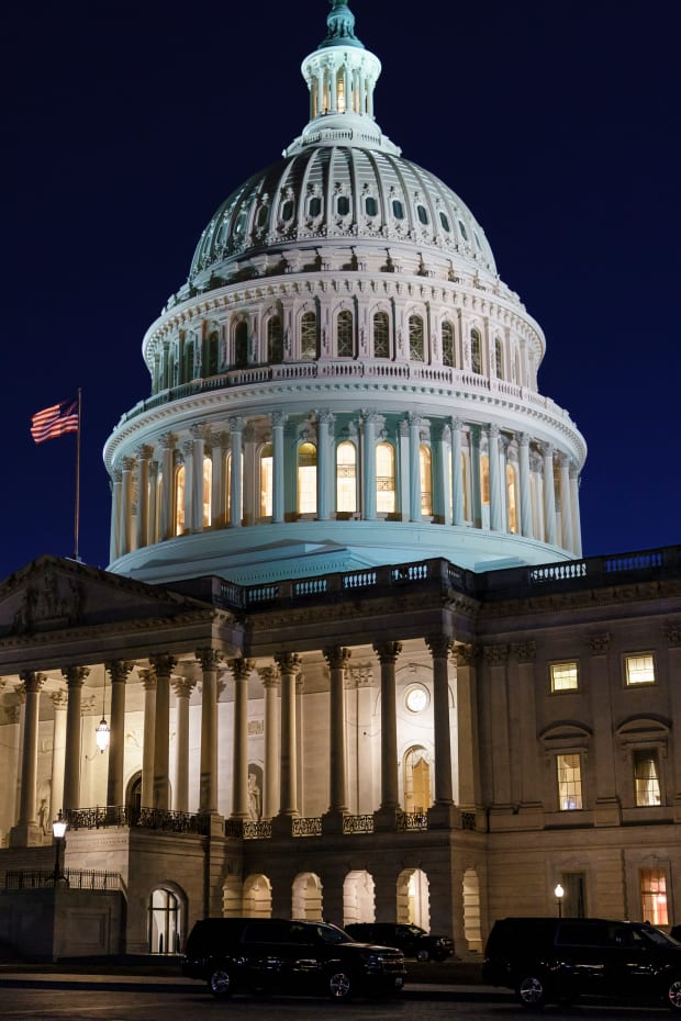The Capitol is seen at dusk as work in the Senate is stalled on the Democrats' $1.9 trillion COVID-19 relief bill, in Washington, Friday, March 5, 2021. Senators plan to continue to vote on amendments through the night. (AP Photo/J. Scott Applewhite)