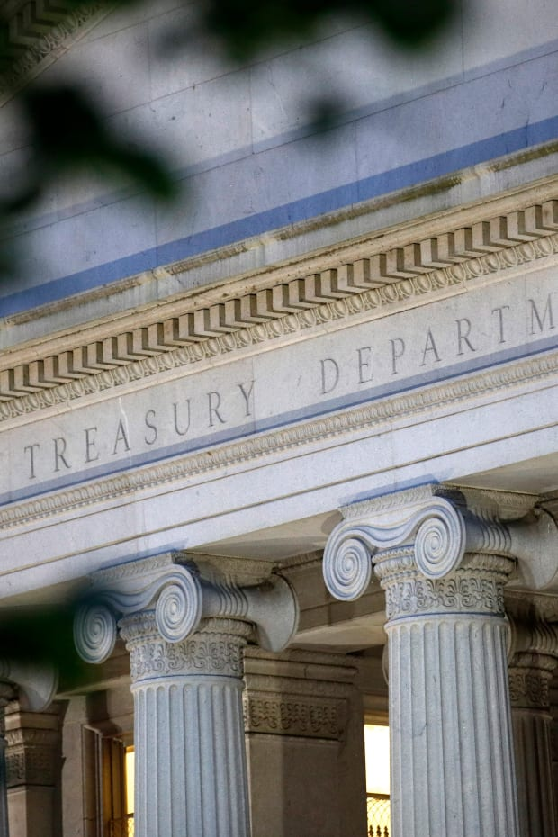 This June 6, 2019, file photo shows the U.S. Treasury Department building at dusk in Washington. Multiple published reports say that the U.S. government has launched a national-security review of the China-owned video app TikTok, popular with millions of U.S. teens and young adults. Several senators have recently noted concerns about censorship and data collection on TikTok. The Treasury Department, which houses CFIUS, says it does not comment on specific cases. (AP Photo/Patrick Semansky, File)
