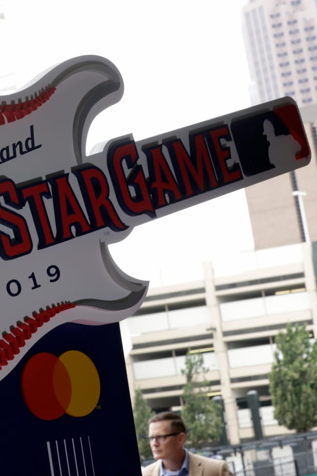 """The new logo for the 2019 All-Star Game is displayed, Tuesday, Aug. 7, 2018, in Cleveland. The Indians are reviewing their contentious nickname. The team released a statement on Friday, July 3, 2020 saying it is committed to """"making a positive impact in our community and embrace our responsibility to advance social justice and equality."""" The club said it plans to review a nickname it has had since 1905.(AP Photo/Tony Dejak, file)"""