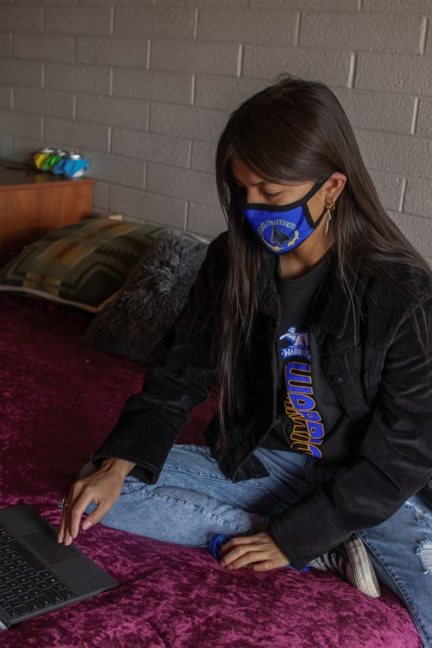 """Latrinda Tohe enrolled at Diné College to learn more about her people's traditions. """"I feel like everyone on the reservation is family,"""" she says. March 23, 2021 (Photo by Jeff Rosenfield/Cronkite News)"""