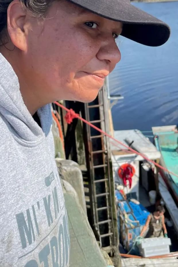 Shy Francis looks out over the water off the wharf in Nova Scotia. Photo: Angel Moore/APTN.