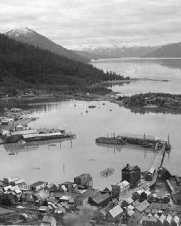 "Village of Wrangell, ca. 1897, one of the five ""landless"" communities in Southeast Alaska whose Native residents were excluded from full participation in the Alaska Native Claims Settlement Act. Ironically, Wrangell was the hometown of William Paul, Sr., the pioneering Tlingit civil rights leader who is considered one of the fathers of the Native land claims movement. (Photo courtesy of the University of Washington Libraries)"