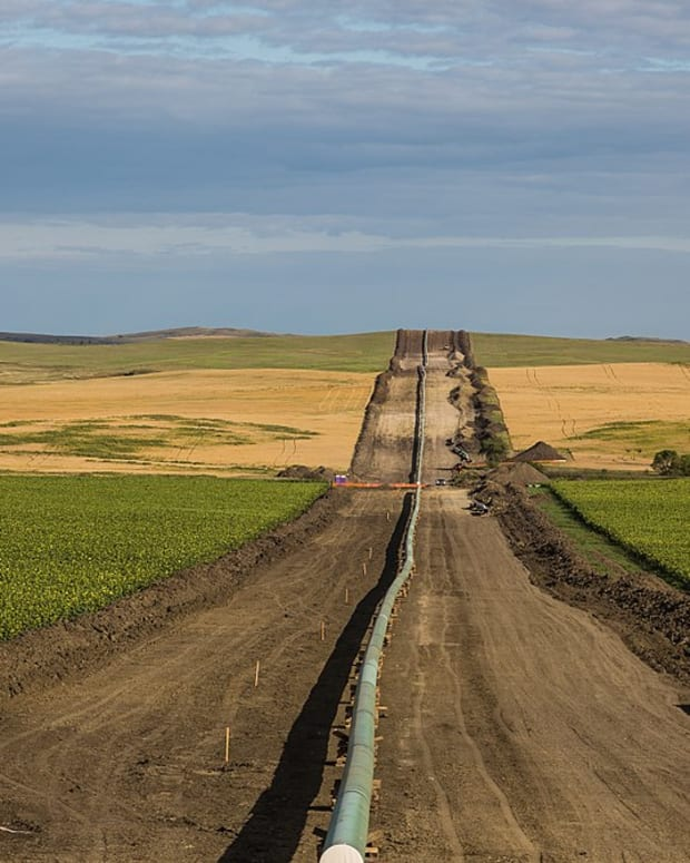 Pictured: The Dakota Access Pipeline under construction being installed between farms, as seen from 50th Avenue in New Salem, North Dakota. The pipeline extends from Illinois to North Dakota.