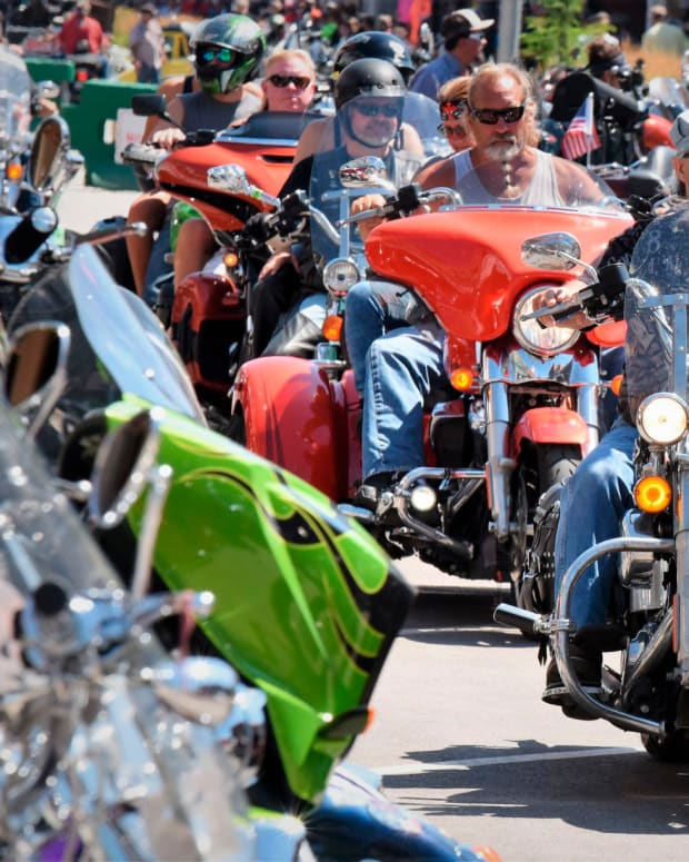This Aug. 2, 2019 photo shows Heavy traffic on legendary Main Street in Sturgis, S.D., South Dakota, which has seen an uptick in coronavirus infections in recent weeks, is bracing to host hundreds of thousands of bikers for the 80th edition of the Sturgis Motorcycle Rally. More than 250,000 people are expected to attend the Aug. 7 to Aug. 16 rally in western South Dakota. (Jim Holland/Rapid City Journal via AP)