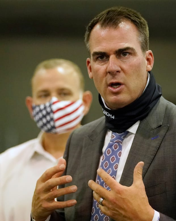 In this Aug. 18, 2020 file photo, Oklahoma Gov. Kevin Stitt answers a question during a news conference at the Central Oklahoma PPE distribution warehouse Tuesday, Aug. 18, 2020, in Oklahoma City. Oklahoma had the fifth highest rate of newly reported coronavirus cases last week, according to a report from the White House Coronavirus Task Force report released Wednesday, Sept. 16, 2020, and the task force is again recommending a statewide mandate require masks. (AP Photo/Sue Ogrocki)