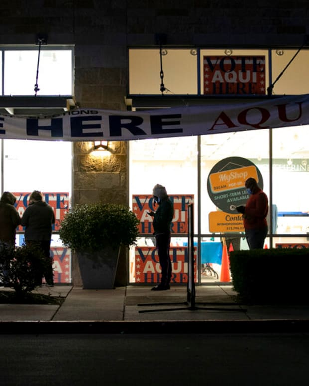 People wait in line to vote in Austin, Texas, before the polls opened at 7 a.m. on Tuesday Nov. 3, 2020. (Jay Janner /Austin American-Statesman via AP)