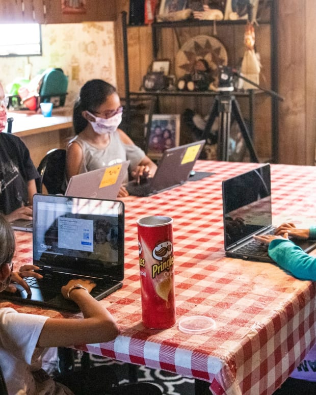 When they aren't working in the family vehicle, the Begaye sisters – from left, high school senior Chenoa, fourth-grader Sonora, first-grader Annabah and second-grader Winona – usually sit around the kitchen table doing schoolwork. (Photo by Megan Marples/Cronkite News)