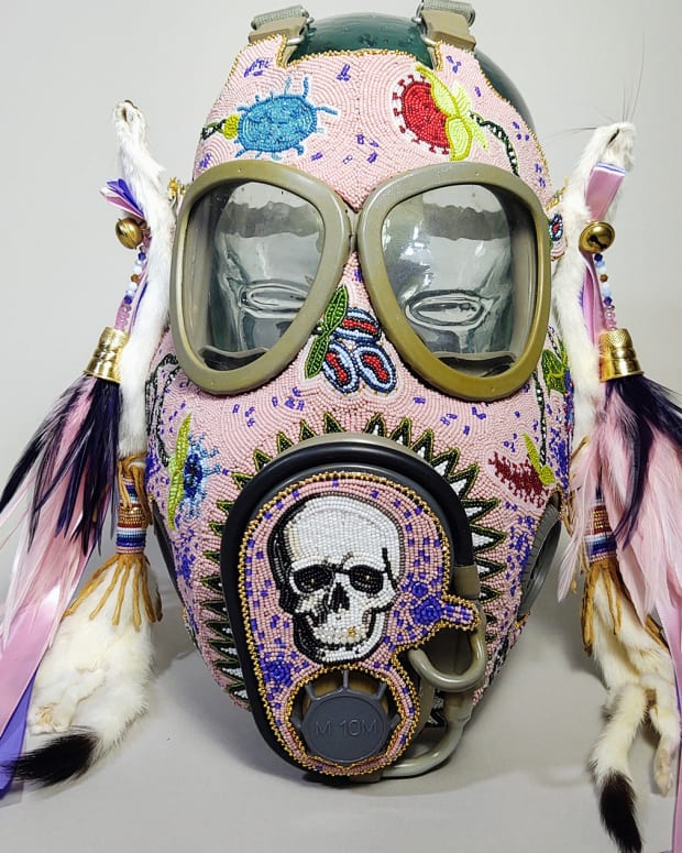 """Dallin Maybee, Northern Arapaho/Seneca, wins Best In Show for """"Pestilence: COVID, Smallpox, Black Plague – A Floral Gas Mask"""" at the 15th Annual Cherokee Art Market."""