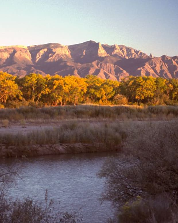 Pictured: New Mexico's Sandia Mountains at sunset, looking Southeast from Bernalillo. Below is the Rio Grande, part of the state's proposed Rio Grande Trail.