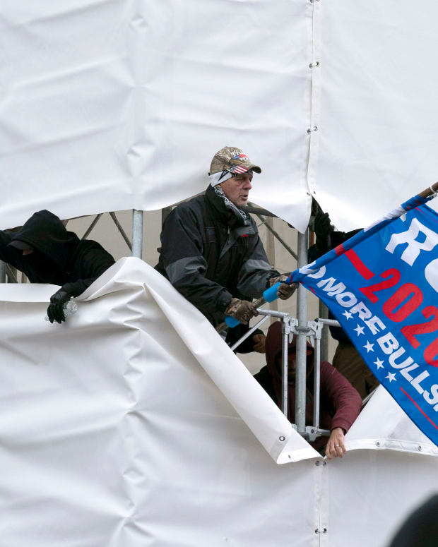 Trump supporters are seen outside the Capitol, Wednesday, Jan. 6, 2021, in Washington. As Congress prepares to affirm President-elect Joe Biden's victory, thousands of people have gathered to show their support for President Donald Trump and his claims of election fraud. (AP Photo/Jose Luis Magana)