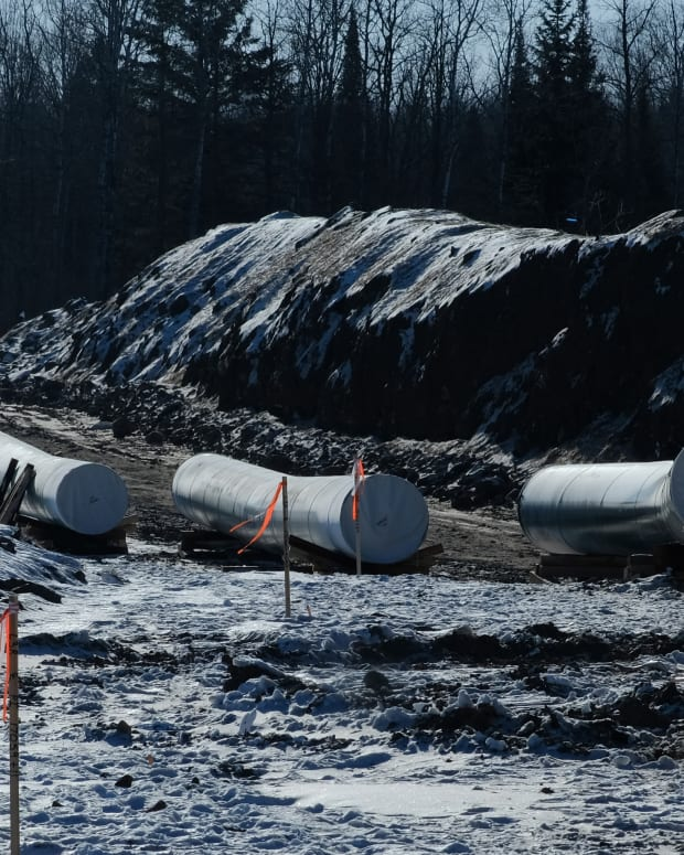 Sections of pipe await placement near Grand Rapids, MN for the Enbridge Line 3 project. (Photo by Mary Annette Pember)