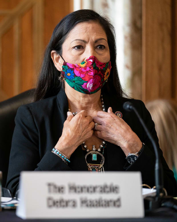 Rep. Debra Haaland, D-New Mexico, arrives to testify before a Senate Committee on Energy and Natural Resources hearing on her nomination to be Secretary of the Interior on Capitol Hill in Washington, Wednesday, Feb. 24, 2021. (Sarah Silbiger/Pool via AP)