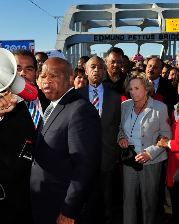 "In this March 4, 2012, file photo, U.S. Rep. John Lewis, D-Ga., center, talks with those gathered on the historic Edmund Pettus Bridge during the 19th annual reenactment of the ""Bloody Sunday"" Selma to Montgomery civil rights march across the bridge in Selma, Ala. The March 7, 2021, Selma Bridge Crossing Jubilee will be the first without the towering presence of Lewis, as well as the Rev. Joseph Lowery, the Rev. C.T. Vivian and attorney Bruce Boynton, who all died in 2020. (AP Photo/Kevin Glackmeyer, File)"