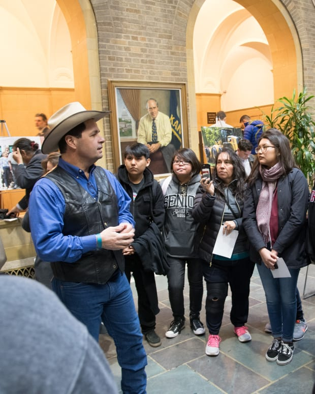 Intertribal Agriculture Council Member Zach Ducheneaux chats with Navajo Nation high school students while in the Whitten Building Patio before Vice President Mike Pence commemorates National Agriculture Day and delivers remarks regarding President Donald J. Trump's National Ag Day Proclamation at the U.S. Department of Agriculture (USDA) headquarters in Washington, D.C., on March 20, 2018. Vice President Pence's address includes the importance of agriculture and honoring America's farmers, ranchers, and foresters, with a special recognition of youth. (Photo by Lance Cheung, U.S. Department of Agriculture)