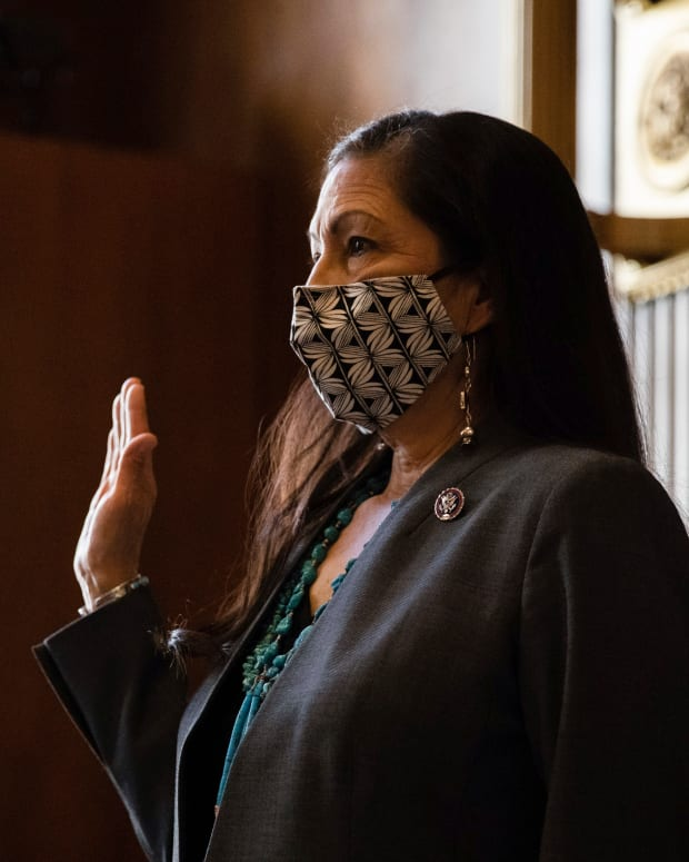Rep. Deb Haaland, D-New Mexico, is sworn in during a Senate Committee on Energy and Natural Resources hearing on her nomination to be Interior Secretary, Tuesday, Feb. 23, 2021 on Capitol Hill in Washington. (Graeme Jennings/Pool via AP)