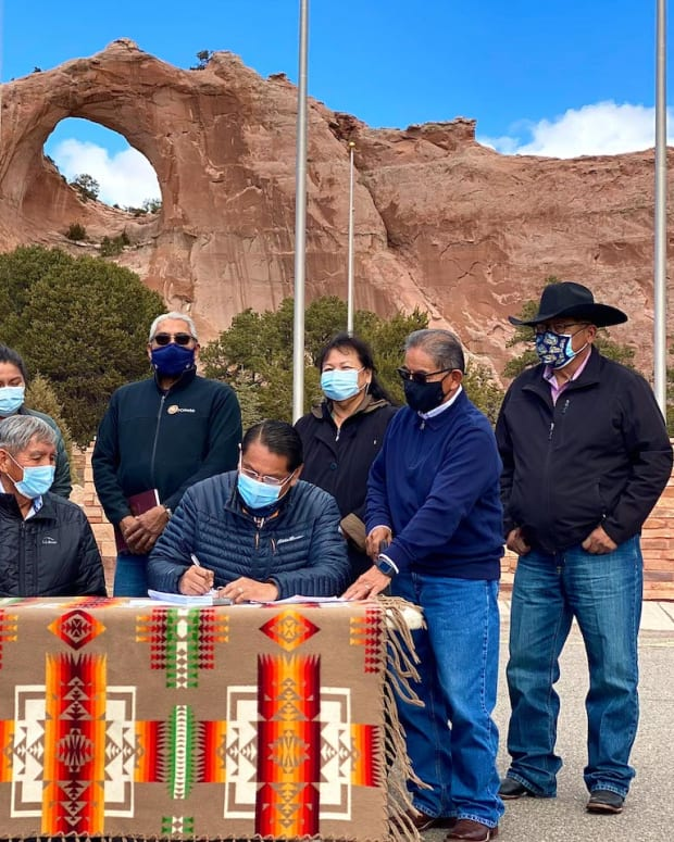 Pictured: Navajo Nation President Jonathan Nez signs a new land lease to allow the construction of staff quarter units.