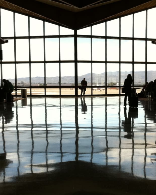 A lone passenger is silhouetted against the windows at Phoenix Sky Harbor International Airport's Terminal 4 in this file photo. While Memorial Day weekend is traditionally the start of the summer travel season, experts say it is nearly impossible to predict who travel will be this weekend, as the nation tries to emerge from COVID-19 shutdowns. (Photo by Alan Levine/Creative Commons)