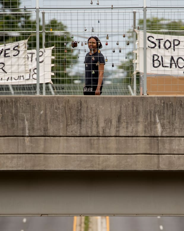 "Signs that read ""Black Lives Matter"" and ""Stop Killing Black People"" hang on an overpass on North Capitol Street in Washington, Tuesday, June 2, 2020, following days of continuing protests over the death of George Floyd. Floyd died after being restrained by Minneapolis police officers. (AP Photo/Andrew Harnik)"