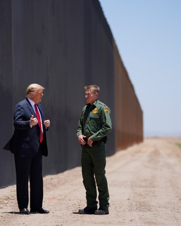 President Donald Trump speaks with Rodney Scott, the U.S. Border Patrol Chief, as he tours a section of the border wall, Tuesday, June 23, 2020, in San Luis, Ariz. (AP Photo/Evan Vucci)