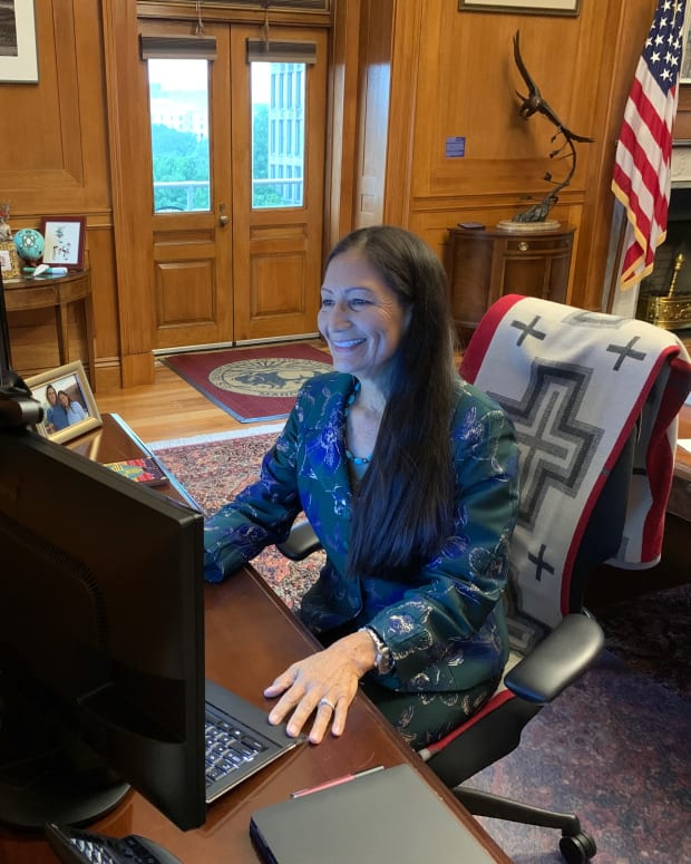 """Interior Secretary Deb Haaland in her office welcoming the department's new law enforcement task force to ensure the department """"implements the highest standards for protecting the public and provides necessary policy guidance, resources, and training."""" (Photo courtesy of Interior Secretary Deb Haaland via Twitter)"""