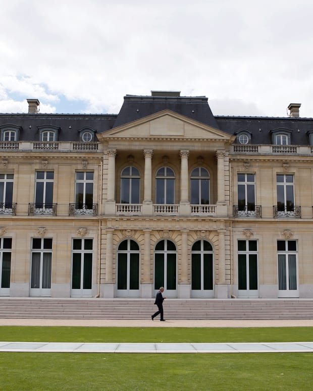 FILE - In this June 7, 2017 file photo, the Organisation for Economic Co-operation and Development (OECD) headquarters is pictured in Paris, France. Nearly 140 countries have agreed on a tentative deal that would make sweeping changes to how big, multinational companies are taxed in order to deter them from stashing their profits in offshore tax havens where they pay little or no tax. The agreement announced Friday foresees countries enacting a global minimum corporate tax of 15% on the biggest, internationally active companies. (AP Photo/Francois Mori, File)