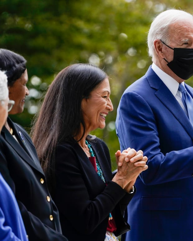President Joe Biden gestures on the North Lawn of the White House in Washington, Friday, Oct. 8, 2021, with White House national climate adviser Gina McCarthy, Brenda Mallory, chair of the council on environmental quality, and Interior Secretary Deb Haaland during an event announcing that his administration is restoring protections for two sprawling national monuments in Utah that have been at the center of a long-running public lands dispute, and a separate marine conservation area in New England that recently has been used for commercial fishing. (AP Photo/Susan Walsh)