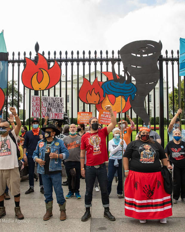 Pictured: Day 3 of 'People vs Fossil Fuels' protest. People who volunteered to be arrested stand in front of the White House during a demonstration against fossil fuels on Wednesday, October 13, 2021, in Washington, DC.
