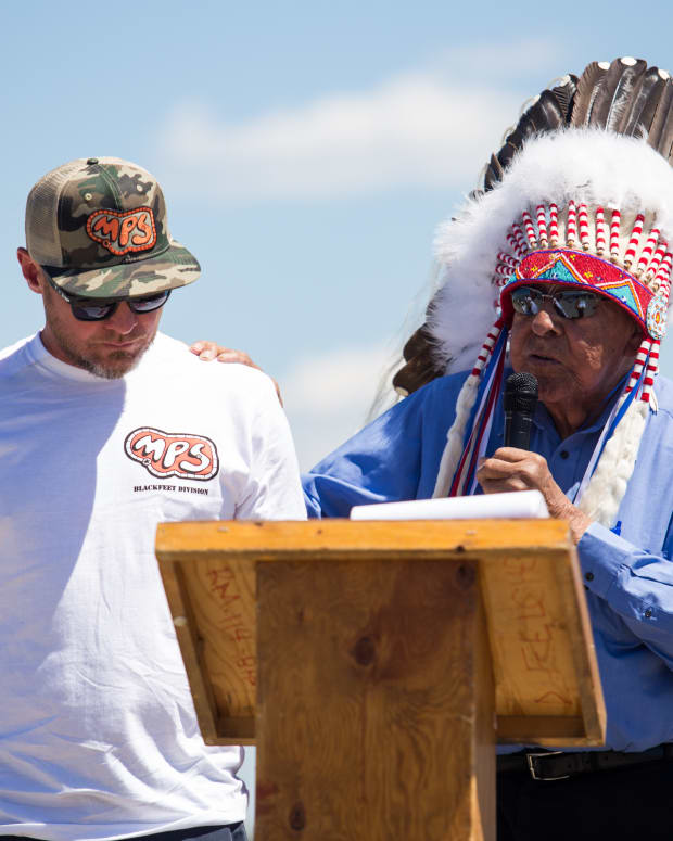 Blackfeet Nation Chief, Earl Old Person, gives Pearl Jam bassist and Big Sandy native, Jeff Ament, a traditional Blackfeet name for his contribution of a skate park to the community of Browning on June 25, 2015. (Photo by Great Falls Tribune)